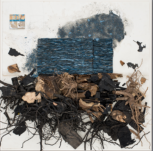 an abstract work with blue and brown pieces.  The darker pieces have the appearance of roots.