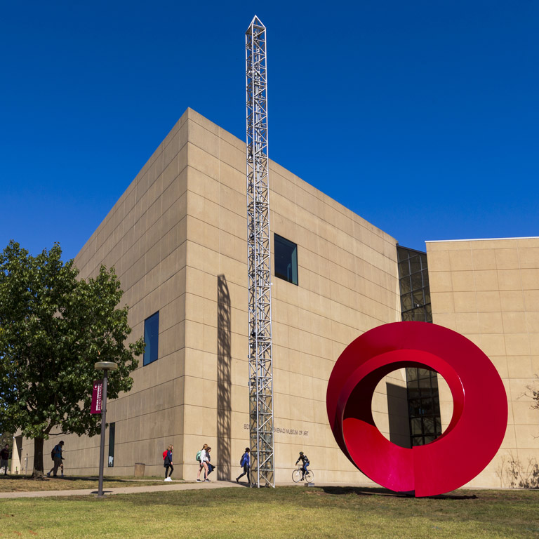 The front of the art museum, with the red circular sculpture Indiana Arc in the foreground.