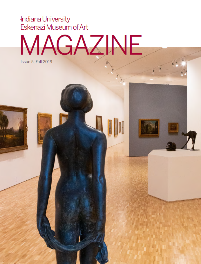 Cover of issue 5 of magazine, showing the back of a bronze sculpture of a nude woman.  The background of the shot features more of the gallery and artworks on the wall.
